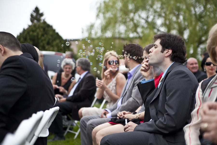 Montreal Wedding Photographer blowing bubbles
