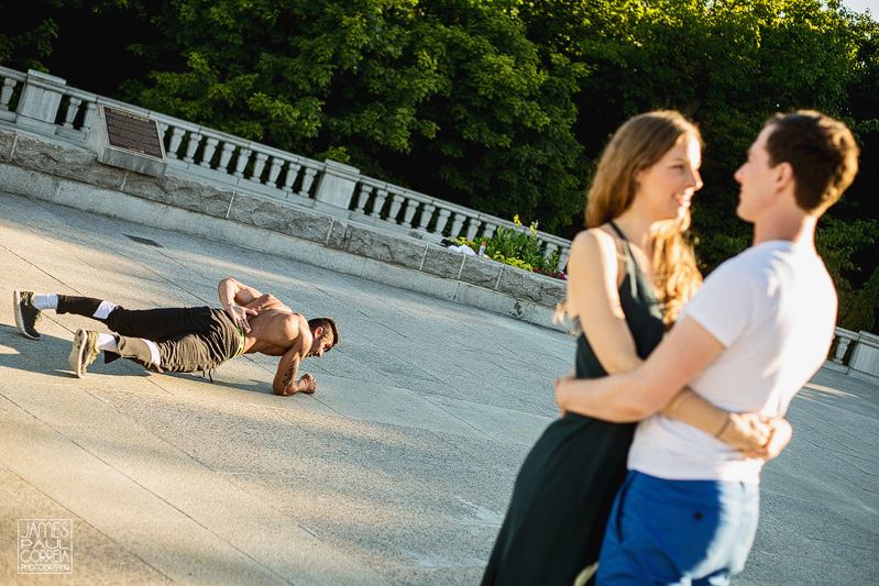 Montreal Mont Royal Engagement Candid with fitness guy planking