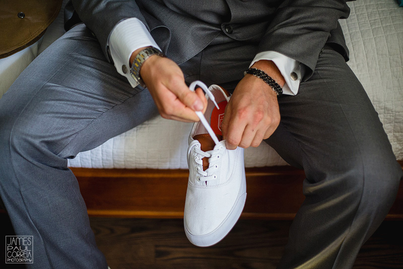 Montreal Wedding Photographer groom putting on shoes