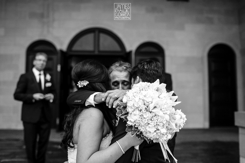 father embrace wedding photographer