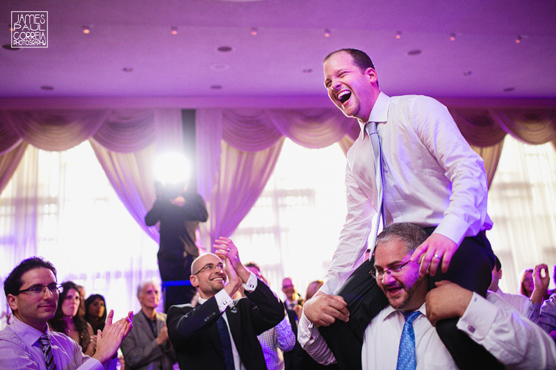 jewish wedding groom on shoulders